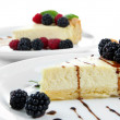Slices of cheesecakes on plate, close-up — Stock Photo #36864033