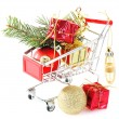 Christmas gifts in shopping trolley, isolated on white — Stock Photo