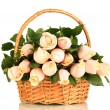 Beautiful bouquet of roses in basket, isolated on white — Stock Photo