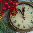 Clock with fir branches and Christmas decorations under snow close up — Stock Photo #36866107