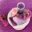 Hand made soap with sea salts on purple plate close-up — Stock Photo