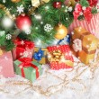 Decorated Christmas tree with gifts close-up — Stock Photo #36867959