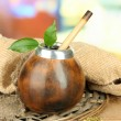 Stock Photo: Calabash and bombillwith yerbmate on wooden table
