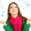 Beautiful smiling girl in warm knit scarf isolated on white — Stock Photo