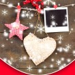 Decorative heart, star and empty photo paper on rope, on wooden background — Photo