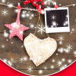 Decorative heart, star and empty photo paper on rope, on wooden background — Stock fotografie