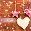 Decorative heart and star on rope, on wooden background — Foto Stock