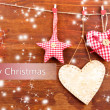 Decorative heart and star on rope, on wooden background — Foto de Stock