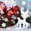 Christmas decorations in basket with snow on table on bright background — Stock Photo