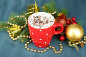 Hot chocolate with cream in color mug, on table, on Christmas decorations background — Photo