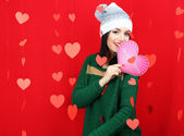 Attractive young woman with card on Valentine Day — Stock Photo