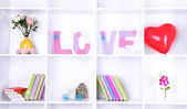 White shelves decorated with handmade knit word — Stock Photo