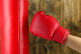 Box training and punching bag, on wooden background — Foto de Stock