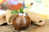 Calabash and bombilla with yerba mate on wooden table — Stock Photo