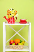 Composition of various home furnishing on white shelf on green wall background — Stock Photo