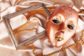 Mask on golden fabric background — Stok fotoğraf