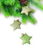 Christmas decorative stars on fir tree, isolated on white — Zdjęcie stockowe