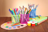 Composition of various creative tools on table on beige background — Stock fotografie