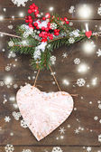Decorative heart on rope, on wooden background — Stockfoto