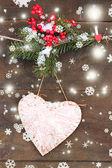 Decorative heart on rope, on wooden background — Zdjęcie stockowe