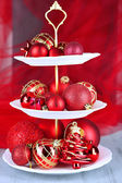 Christmas decorations on dessert stand, on color background — 图库照片