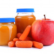 Baby food with carrot and apple in glass jars, isolated on white  — Stock Photo
