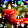 Composition with burning candles, fir tree and Christmas decorations on multicolor lights background — Foto Stock