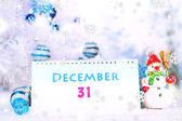 Calendar with New Year decorations on winter background — Zdjęcie stockowe
