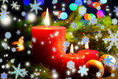 Composition with burning candles, fir tree and Christmas decorations on multicolor lights background — Stock Photo