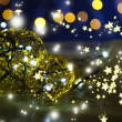 Christmas decorative balls and garland, on dark background — Stock Photo
