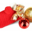 Stock Photo: Red winter mitten with Christmas toys isolated on whited
