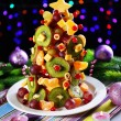 Fruit Christmas tree on table on dark background — Stock Photo
