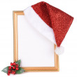 Stock Photo: Christmas hat hung on old frame isolated on white
