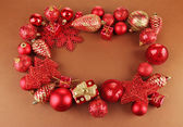 Beautiful Christmas decorations on brown background — Foto de Stock