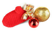Red winter mitten with Christmas toys isolated on whited — Stock Photo
