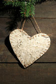 Decorative heart on rope, on wooden background — Stock Photo