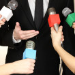 Conference meeting microphones and businessman — Stock Photo #37012859