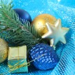 Beautiful Christmas decor on blue cloth — Foto Stock