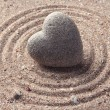 Stock Photo: Grey zen stone in shape of heart, on sand background