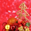 Composition of Christmas balls on red background — Stock Photo