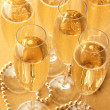 Glasses with champagne on shiny background — Stock Photo