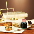 Wooden stamp, scales of justice and old papers on wooden table — Stock Photo #37013615