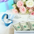 Dollar bills in envelope as gift at wedding on wooden table close-up — Stock Photo #37014119
