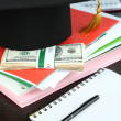 Money for graduation or training on wooden table close-up — Stock Photo