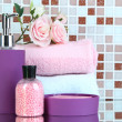 Cosmetics and bath accessories on mosaic tiles background — Stock Photo #37014231
