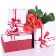 Beautiful gift boxes with flowers isolated on white — Stock Photo