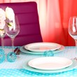 Table serving with colorful tableware on room background — Stock Photo