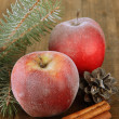 Red frosted apples with fir branch and bumps on wooden background — Foto Stock #37014491