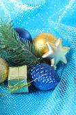 Beautiful Christmas decor on blue cloth — Stock Photo