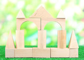 Wood house on grass on natural background — Stock Photo